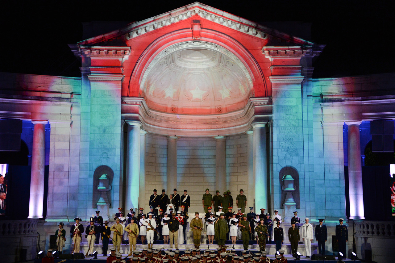 Memorial Amphitheater lit up for an evening performance celebrating Arlington National Cemetery's 150th anniversary
