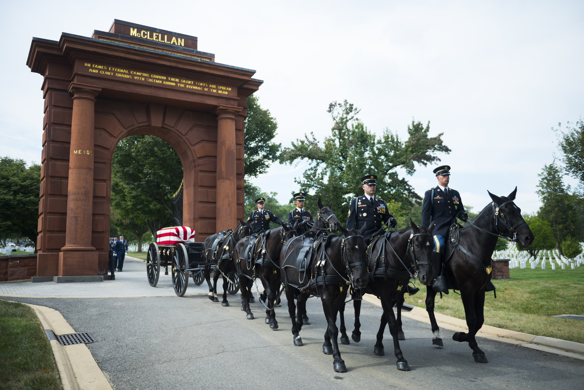 A horse-drawn caisson in a military funeral honors procession