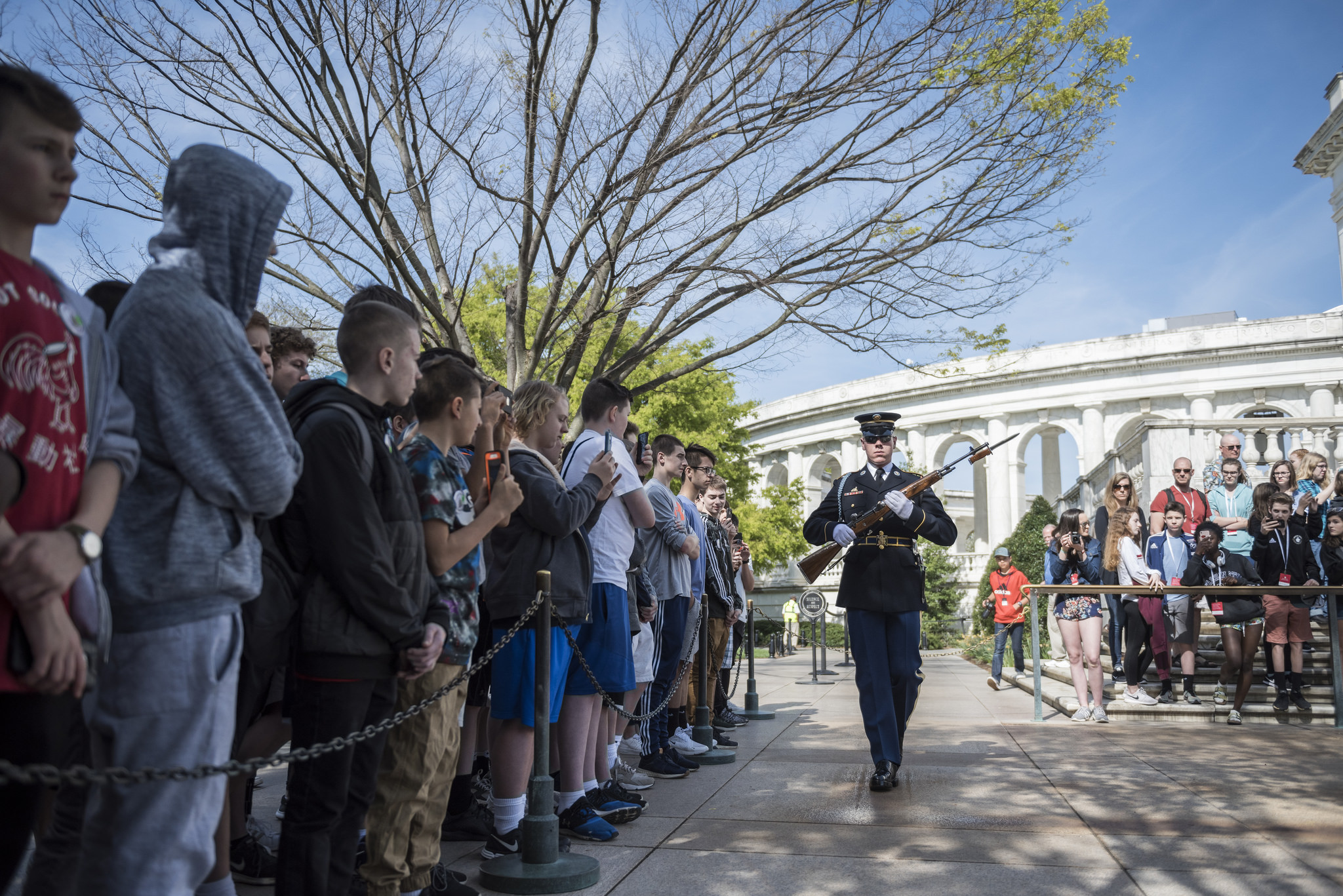 Visitors watch the changing of the guard at the Tomb of the Unknown Soldier