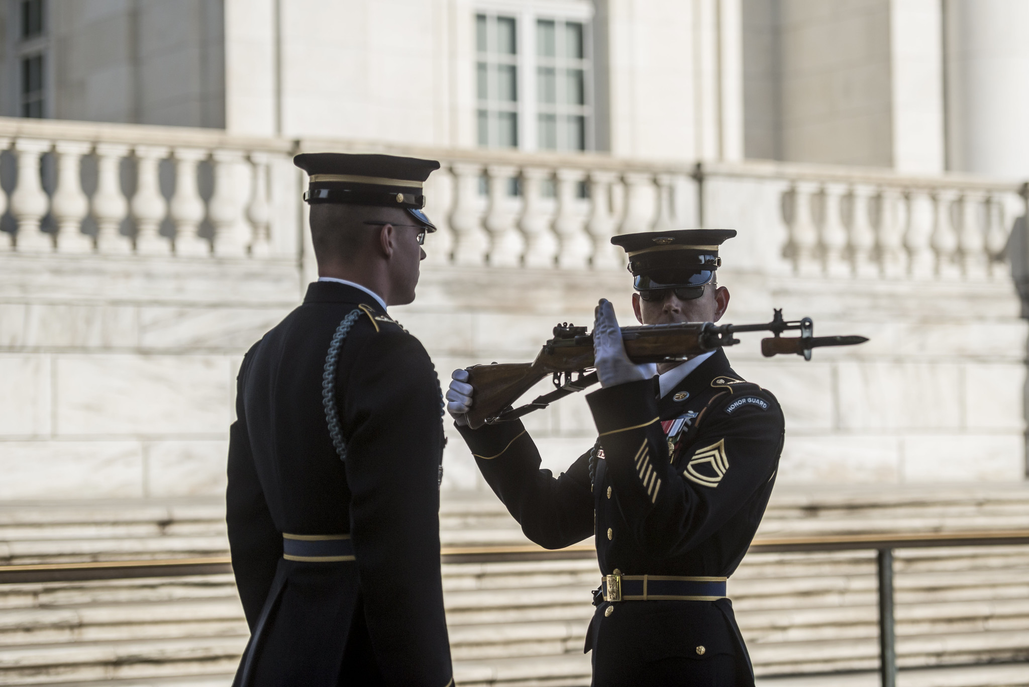 Two members of the 3rd U.S. Infantry Regiment (The Old Guard) participate in the changing of the guard at the Tomb of the Unknown Soldier