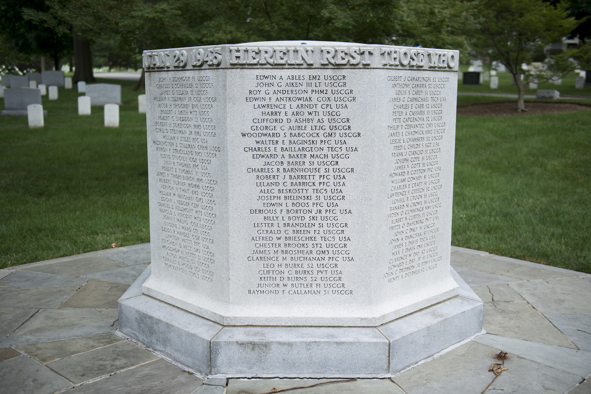 The USS Serpens Monument, an approximately four-foot-tall, octagonal granite marker inscribed with names of the 250 victims of the 1945 Coast Guard disaster