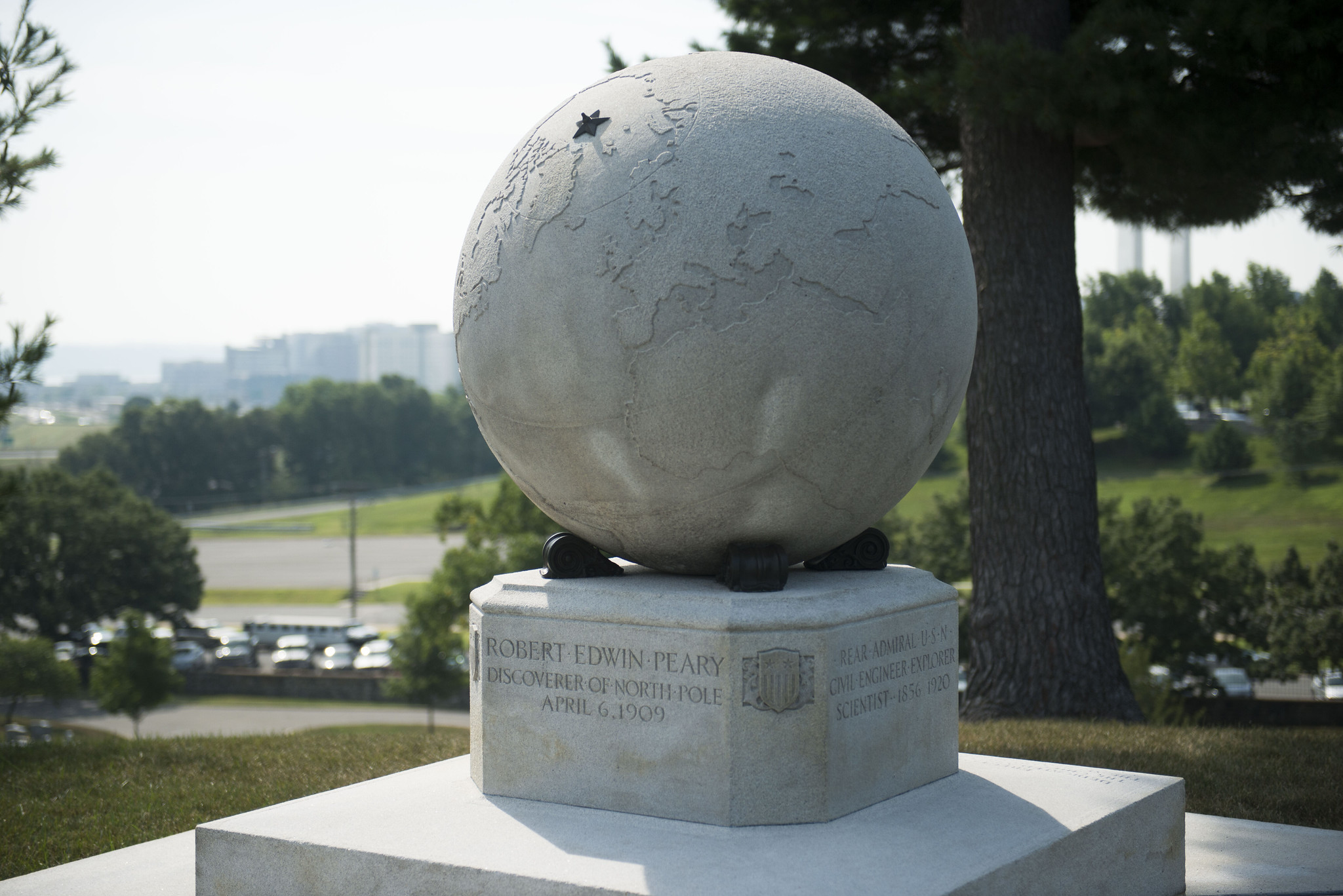A large white marble globe, with a bronze star marking the North Pole, stands at the gravesite of famed Arctic explorer Robert Peary