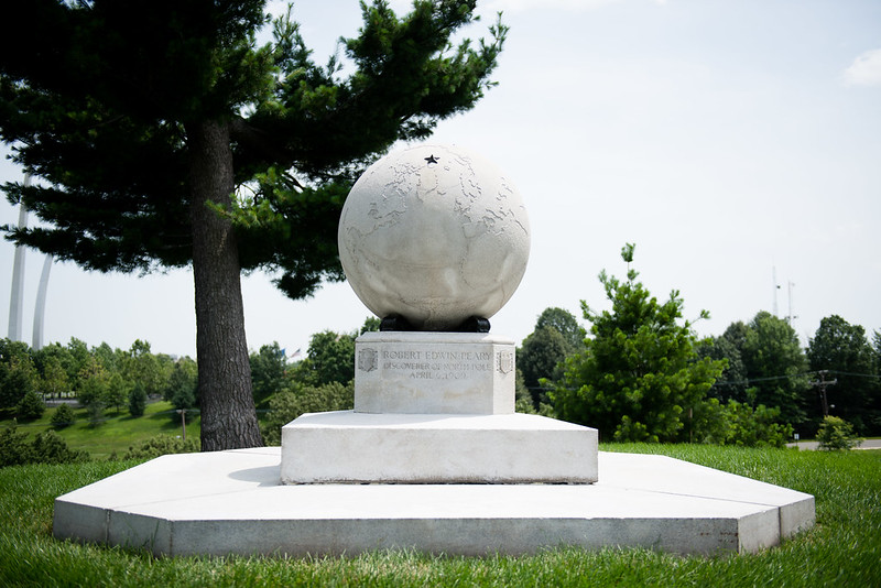 A large white marble globe marks the gravesite of North Pole explorer Robert Peary