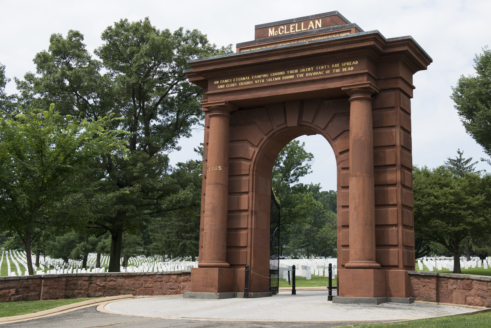 McClellan Gate, with rows of white marble headstones in the background