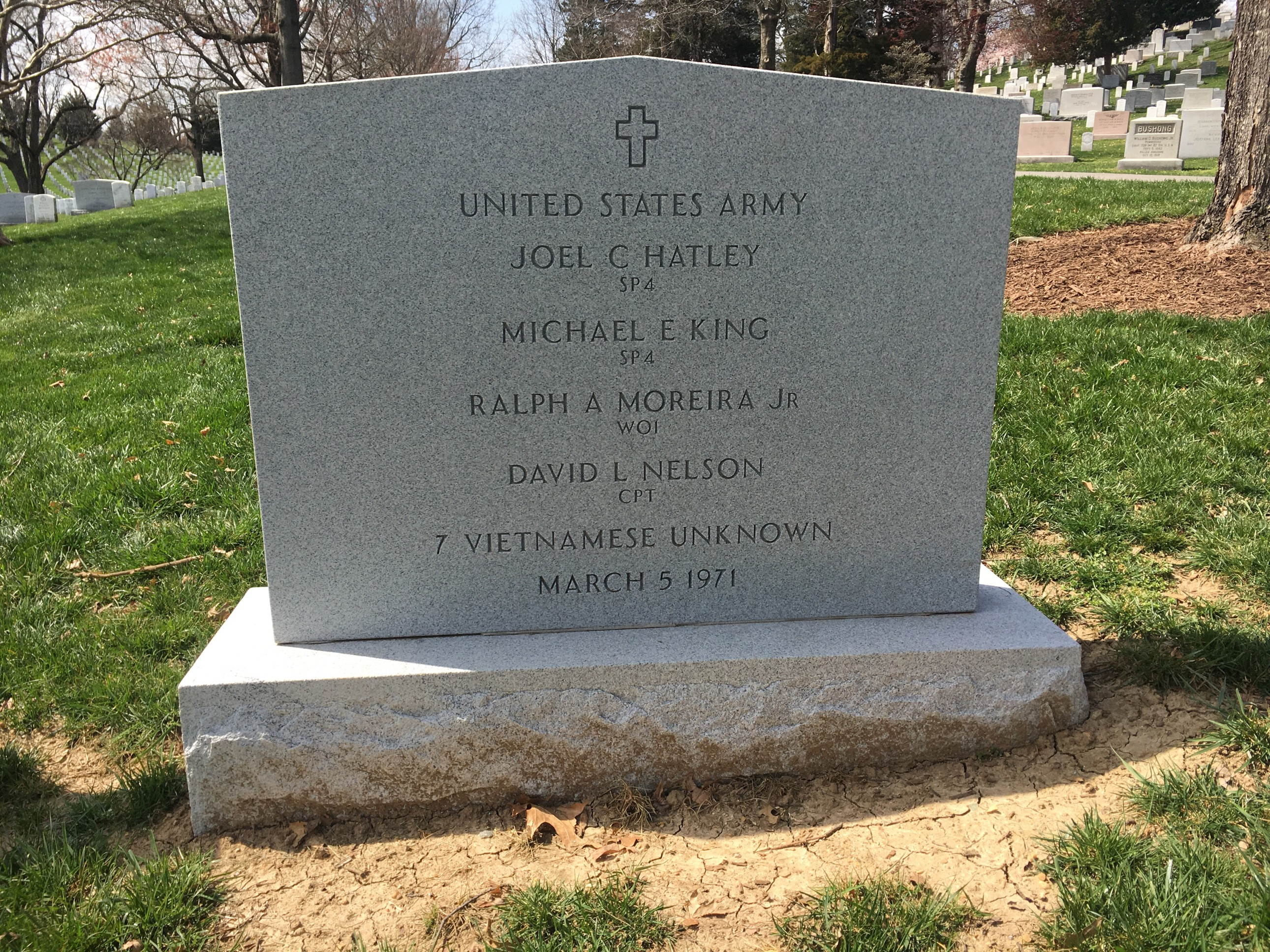 Headstone for a group burial that includes seven unknown South Vietnamese service members