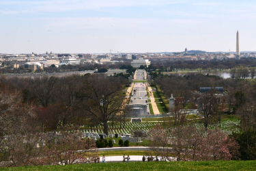 View of the arlington grounds with Potomac river and DC in the distance.