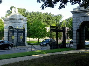 Cars entering the cemetery through a gate